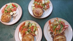 Lunch for four showing the finished pies and a delicious side salad