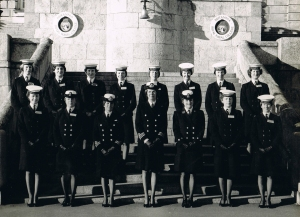 2 rows of women officer cadets plus their Divisional officers on the steps in front of the naval college