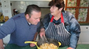 John and Penny close up to the frying pan to catch the smell of mango, chilli and lime.