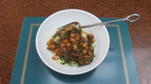 Spinach and chickpea curry served with simple couscous